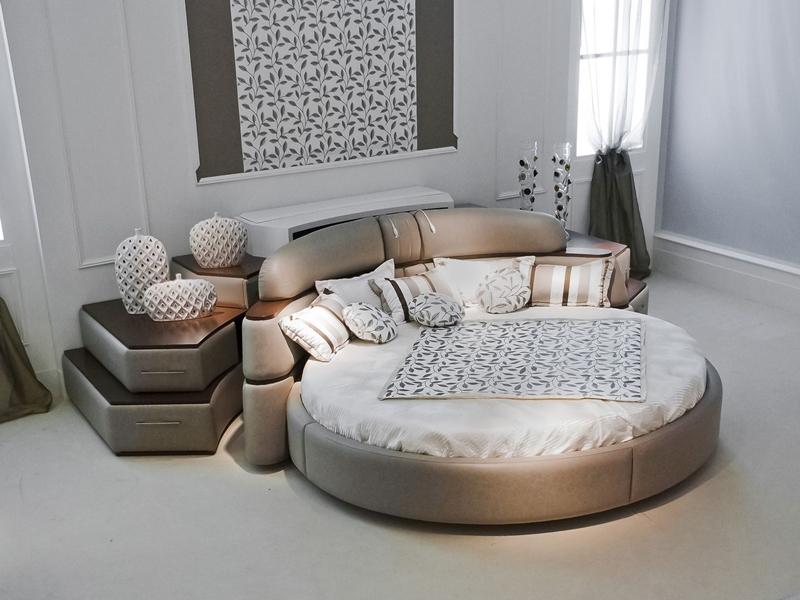 Lit circulaire tournant et meuble librairie tv escamotable for Meuble circulaire