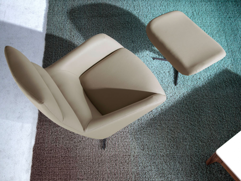 Set of swivel armchair and pouf. Mod. MOMA