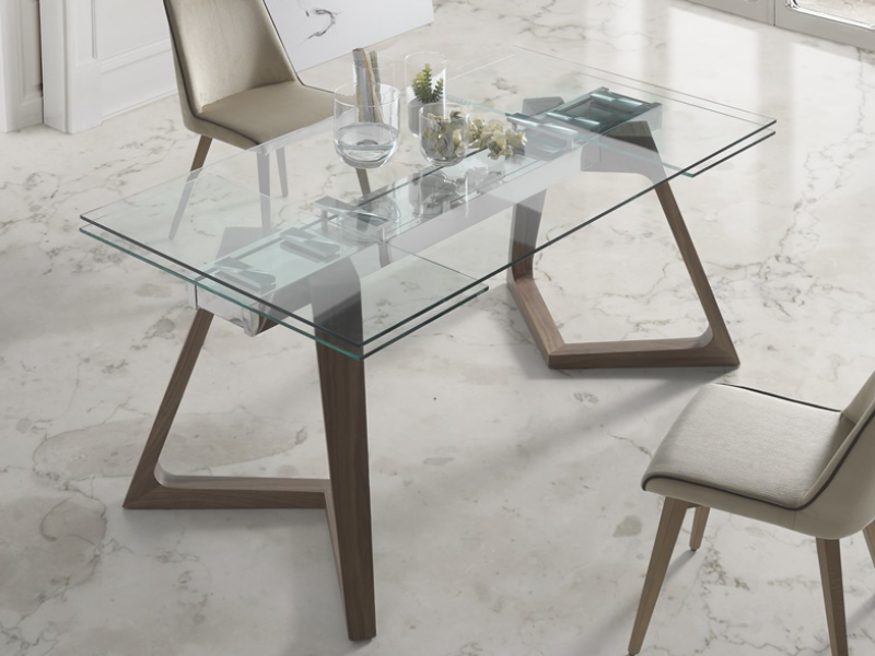 Extensible dining table with glass top. Mod. NAOMI
