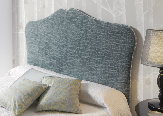 Upholstered headboard with tacks. Mod. TCOLEY