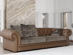 Upholstered sofa  in fabric and leather. Mod. 1735