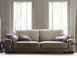 Upholstered sofa in fabric.  Mod.1714