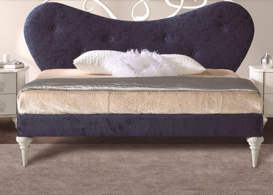 Upholstered bed frame . Mod. SYROS