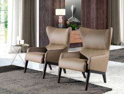 Leather upholstered armchair . Mod. GIA