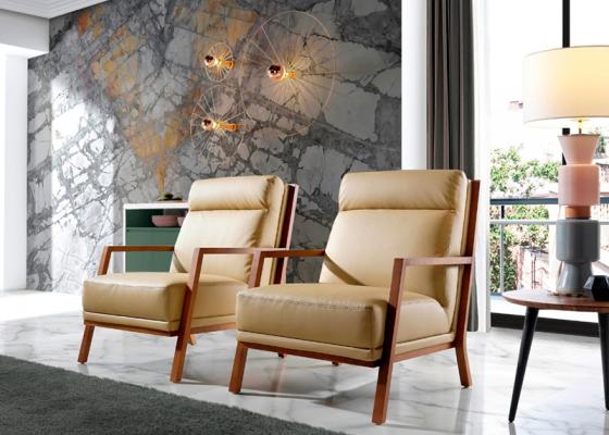 Leather upholstered armchair . Mod. CINNIA