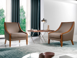 Leather upholstered armchair . Mod. VENUS
