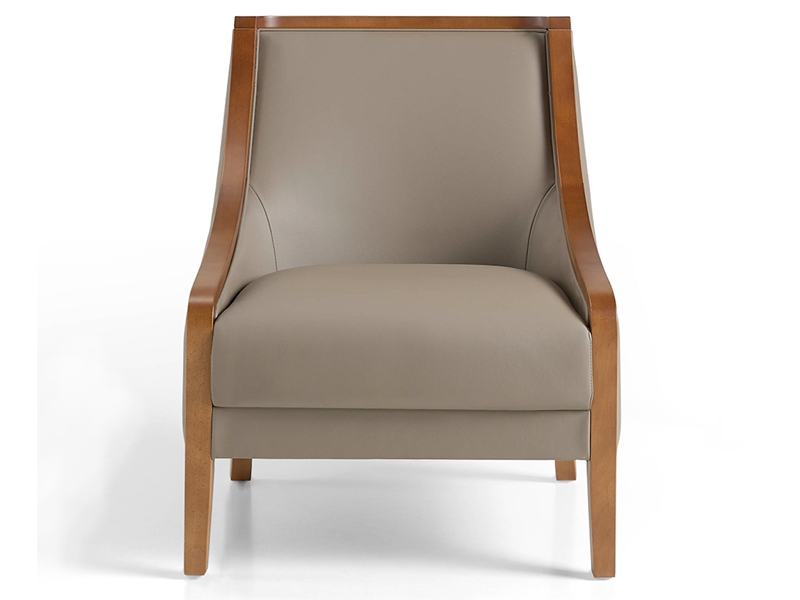 Leather upholstered armchair . Mod. VENUS