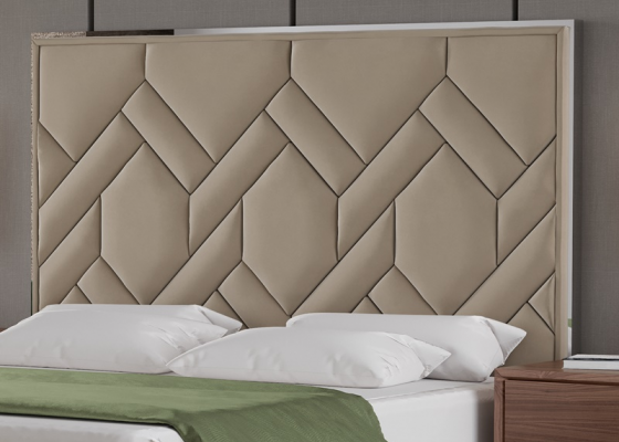 Upholstered headboard with stainless steel. Mod. DORIANNE