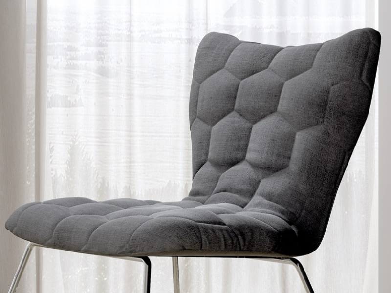 Upholstered chair with stainless steel frame. Mod. KELLY