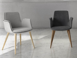 Set of  2 upholstered armchairs with wood base. Mod. RISTO