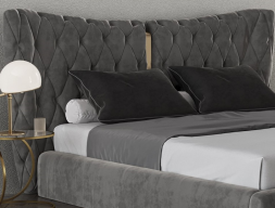 Upholstered and padded headboard with central decorations in polished stainless steel. Mod: KAIPA