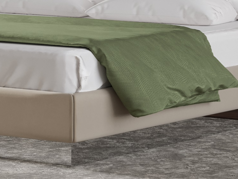 Complete upholstered  bed with polished stainless steel details. Mod: DORIANNE