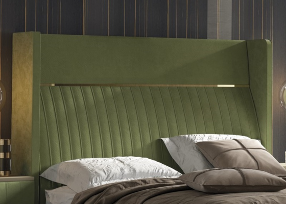 Upholstered headboard with stainless steel details. Mod. CAMILE
