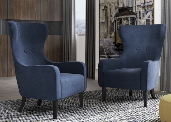 Upholstered armchair with lacquered legs. Mod. BOSTON