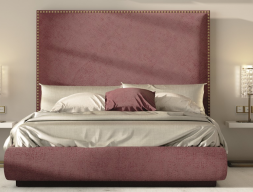 Complete upholstered bed with nails on headboard. Mod. DARIA