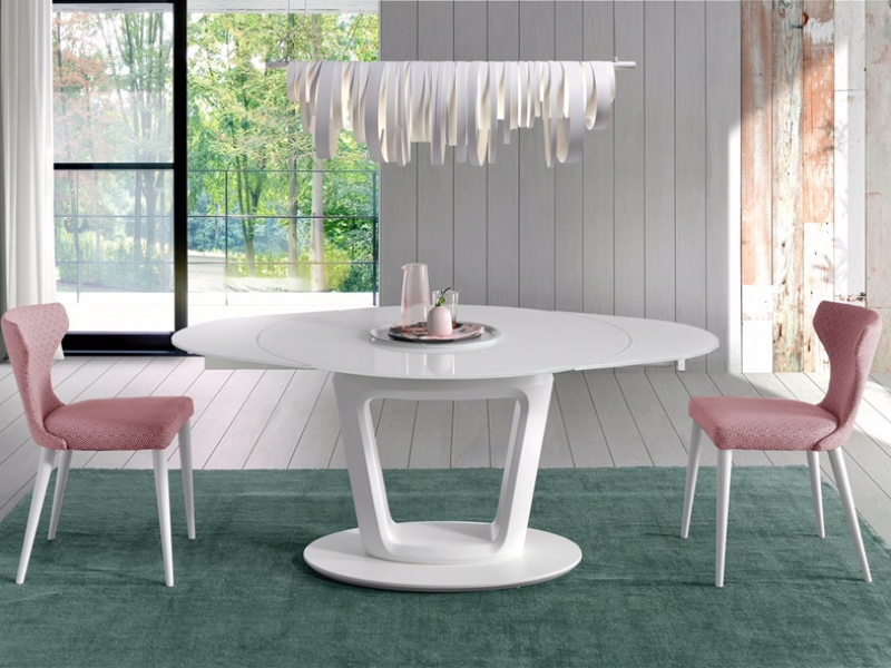 Extendable round dining table . Mod. AGNES