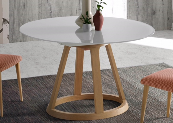 Extendable  round dining table . Mod. JESCA