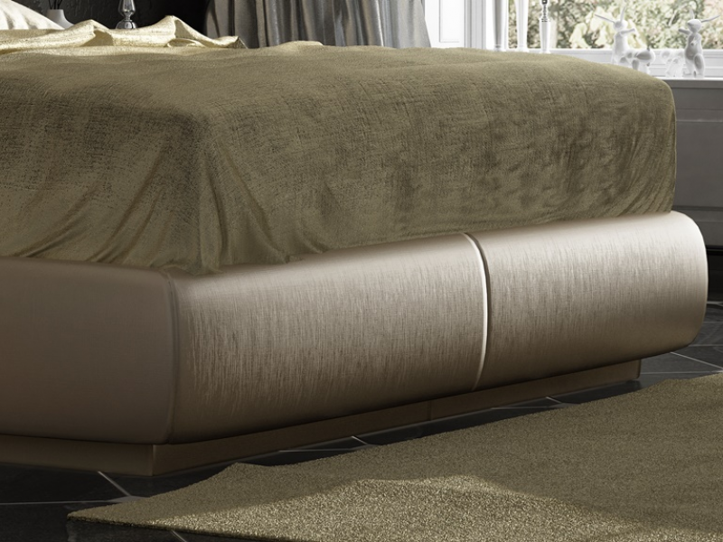 Complete upholstered and lacquered bed with champagne leaf details and Swarovki buttons. Mod. ONUR