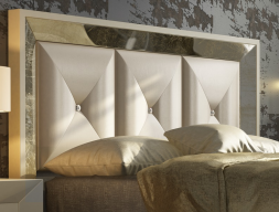 Lacquered and upholstered headboard with Swarovki buttons. Mod. ONUR