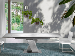 Extendable dining table with stainless steel structure and ceramic top. Mod. FORUM