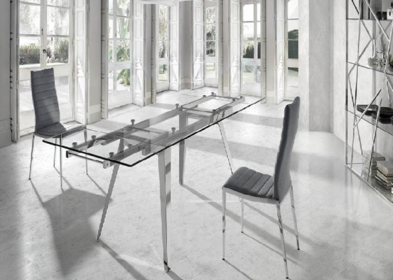 Extendable dining table with steel legs and glass top. Mod. LOTUS