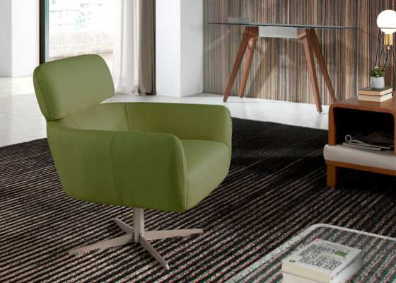 Upholstered swivel armchair . Mod. ZIP