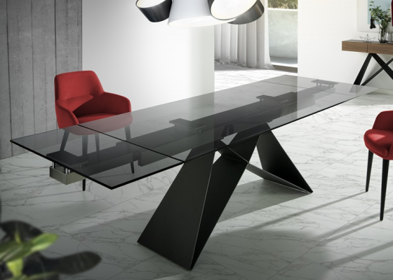 Extendable dining table. Mod. MOON