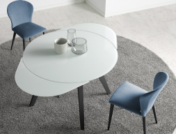 Extendable  round dining table . Mod. DORMA