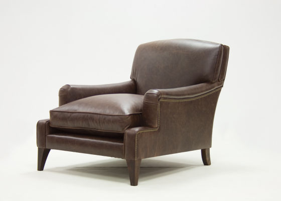 Genuine leather upholstered armchair with nails. Mod. COGNAC LEATHER