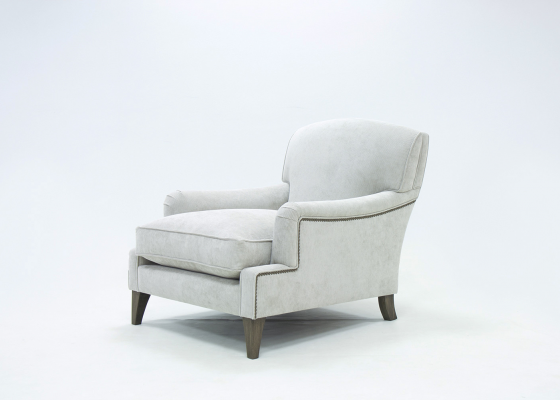 Fabric upholstered  armchair with nails. Mod. COGNAC