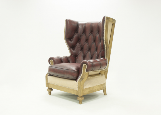 Wing upholstered and padded armchair in leather. Mod. SIR WILLIAMS LEATHER