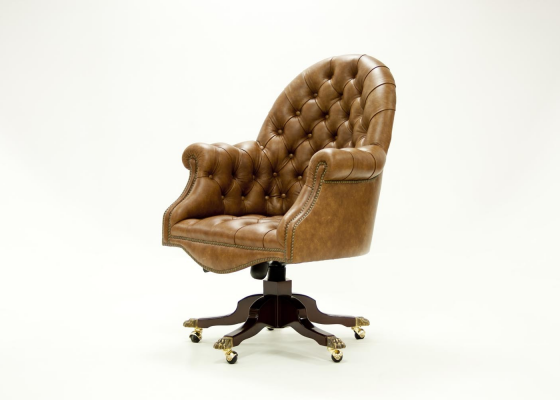 Swivel upholstered and padded armchair with buttons in genuine leather. Mod. MAIRE PADDED