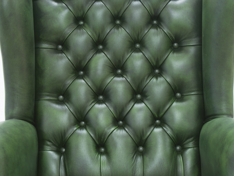 Swivel padded upholstered armchair  with butons in genuine leather. Mod. EXECUTIVE