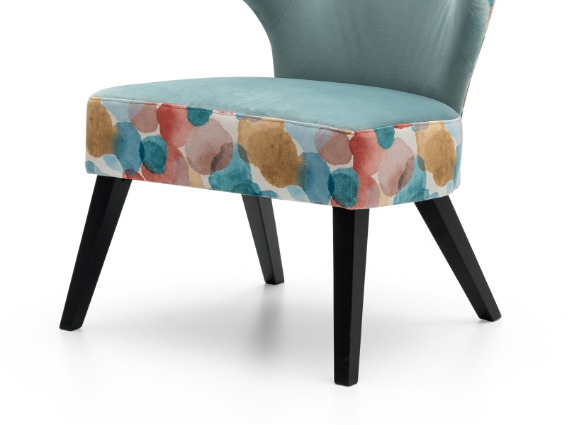 Upholstered low chair. Mod. VALENCIA