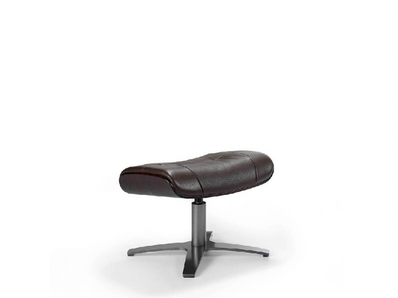 Swivel ottoman upholstered in cowhide.Mod: CAPRICORNE