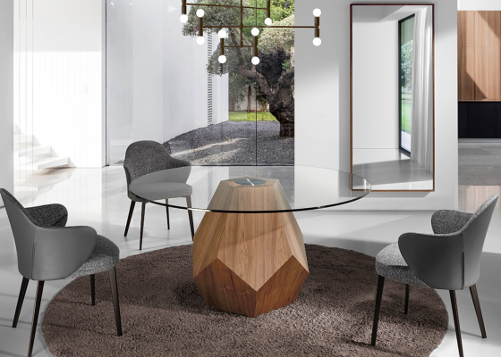Round dining table with  tempered glass top and solid walnut-colored pine wood base.Mod: PESME